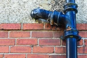 rusty Cast iron plumbing on a wall