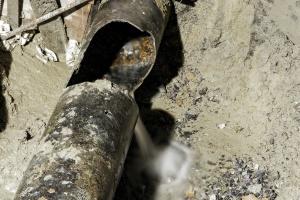 a broken Cast iron plumbing leaking water